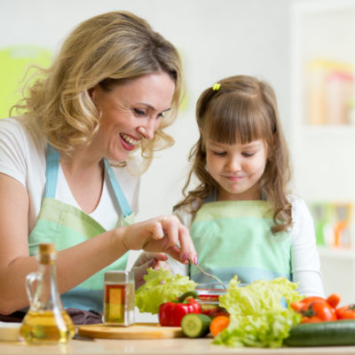 peanut allergy diagnosis - mother and her child preparing and tasting healthy food