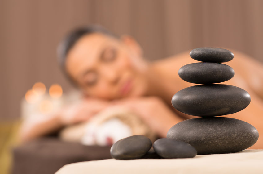 Self-Care Ideas for Food Allergy Moms - Woman Getting Massage with Hot Stones
