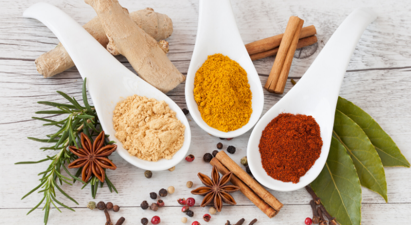 Spoons of Spices on a Cutting Board