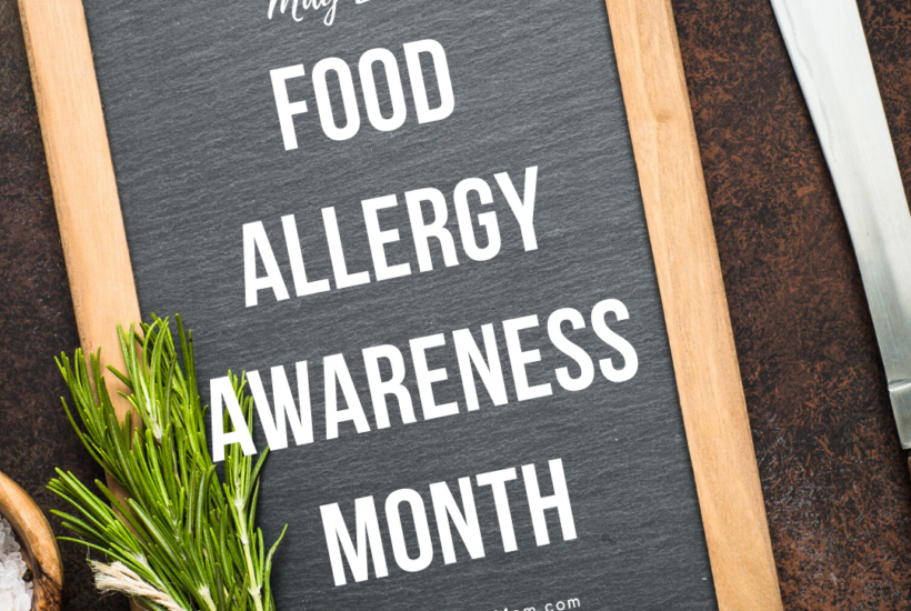 Food Allergy Awareness on chalkboard with vegetables on counter